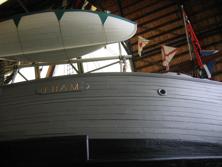 The Fram's name plate and lifeboat